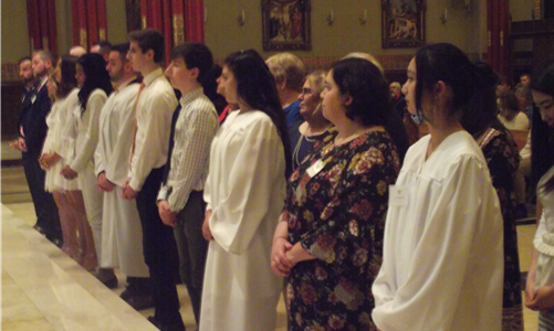 Bishop Cote welcomes 11 Catechumens and Candidates at Easter Vigil Mass